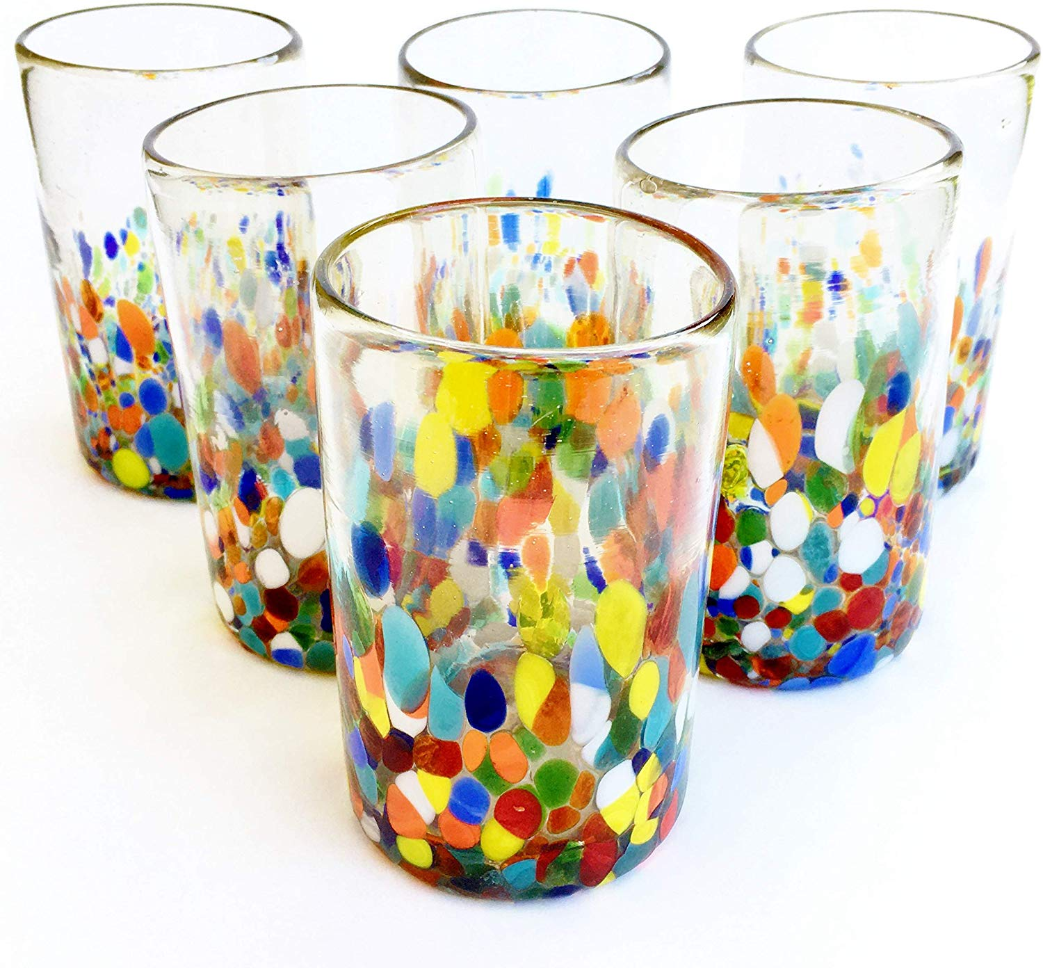 MEXICAN GLASSWARE / Clear & Confetti drinking glasses (set of 6) / Our Clear & Confetti drinking glasses combine the best of two worlds: clear, thick, sturdy handcrafted glass on top, meets the colorful, festive, confetti bottom! These glasses will sure be a standout in any table setting or as a fabulous gift for your loved ones. Crafted one by one by skilled artisans in Tonala, Mexico, each glass is different from the next making them unique works of art. You'll be amazed at how they make having a simple glass of water a happier experience. Each glass holds approximately 14 oz of liquid and stands a bit over 5