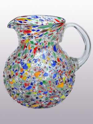 New Items / 'Confetti rocks' blown glass pitcher / Confetti rocks appear to rest inside this modern blown glass pitcher that will make your table setting shine. Each pitcher is adorned with hundreds of tiny multicolor glass particles, giving it a one-of-a-kind look and feel.