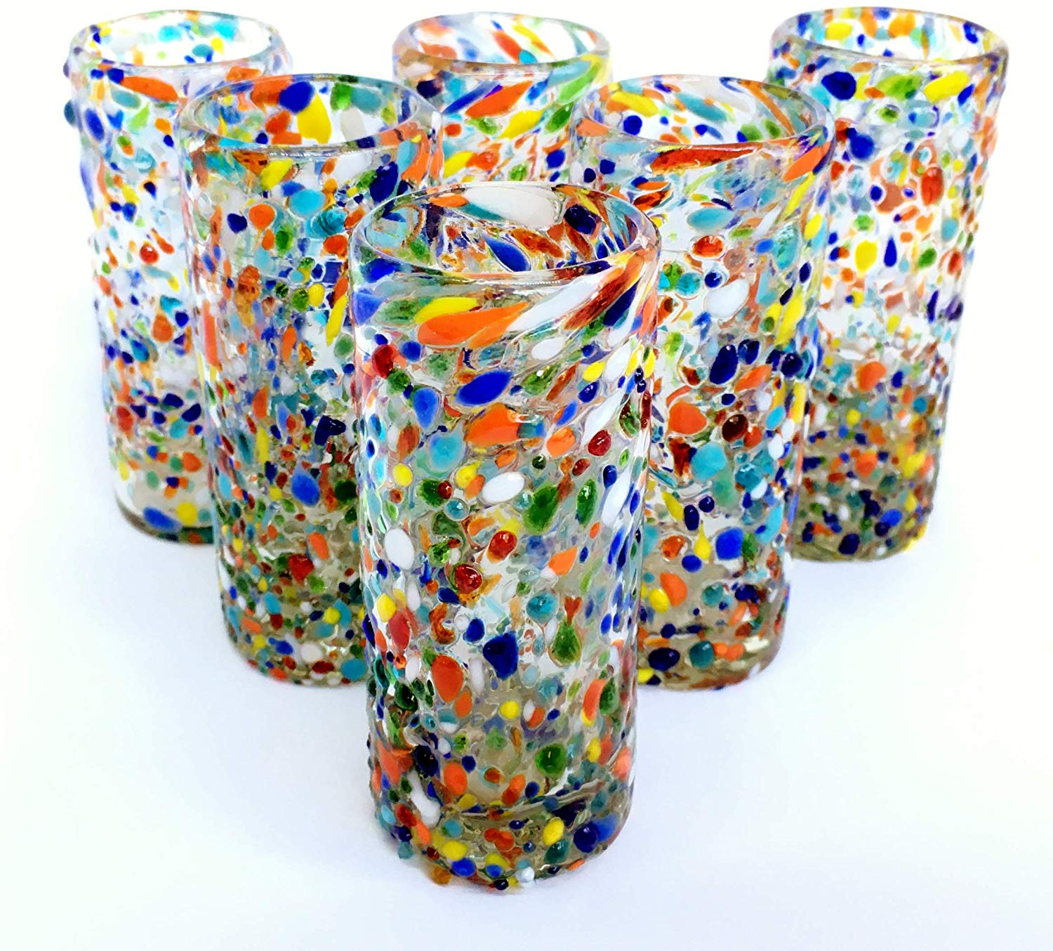 MEXICAN GLASSWARE / 'Confetti Rocks' Tequila shot glasses (set of 6) / Sip your favorite Tequila or Mezcal with these iconic Confetti Rocks shot glasses, which are a must-have of any bar. Crafted one by one by skilled artisans in Tonala, Mexico, each glass is different from the next making them unique works of art. They feature our colorful Confetti rocks design with small colored-glass rounded cristals embedded in clear glass that give them a nice feeling and grip. These shot glasses are festive and fun, making them a perfect gift for anyone. Each glass holds approximately 2 to 3 oz of liquid. Get ready for your next fiesta!!